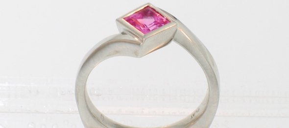 Platinum pink sapphire princess diagonal bezel solitaire ring side view